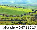Tuscany farmland hill fields in Italy 34711515