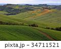 Tuscany farmland hill fields in Italy 34711521