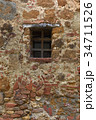 old stone and brick wall with window 34711526