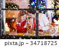 クリスマス お菓子づくり 家族の写真 34718725
