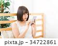 女性 スマートフォン 操作の写真 34722861