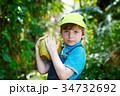 Happy funny little preschool kid boy holding huge 34732692