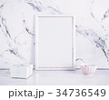 Blank frame and craft box over marble table 34736549