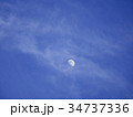 Half moon over the moving clouds 34737336