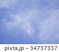 Half moon over the moving clouds 34737337