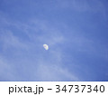 Half moon over the moving clouds 34737340
