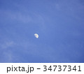 Half moon over the moving clouds 34737341