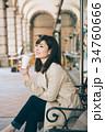 女性 コーヒー ホットコーヒーの写真 34760666