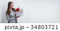 Woman open heart shaped box 34803721