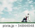 介護医療 看護師 シニア 車椅子 青空 34844048