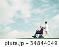 介護医療 看護師 シニア 車椅子 青空 34844049