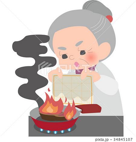濡れ布巾で消火するおばあさん 34845107
