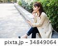 女性 スマホ スマートフォンの写真 34849064