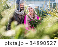 Couple buying Christmas tree on market 34890527