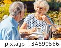 Happy elderly couple eating breakfast in their 34890566