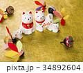 干支 戌の置物(金の和紙背景) 34892604