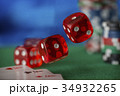 Red dice rotates and will fall 1, casino chips 34932265