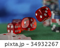 Red dice rotates in the air, casino chips, cards 34932267