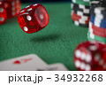 Red dice rotates in the air, casino chips, cards 34932268