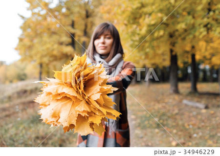 Autumn girl walking in city park. Portrait of 34946229