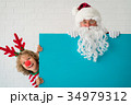 Santa Claus and reindeer child 34979312