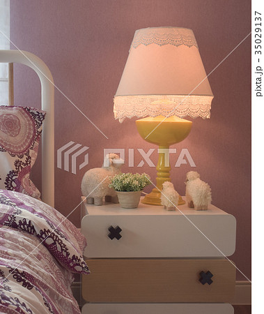 Cozy bedroom with pillow and reading lamp on tableの写真素材 [35029137] - PIXTA