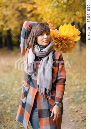Autumn girl walking in city park. Portrait of 35044630