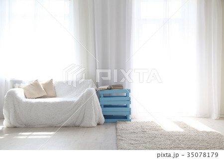 White lounge sofa large Windows and color bookの写真素材 [35078179] - PIXTA