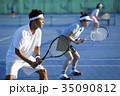 テニスをする男女 ダブルス 35090812