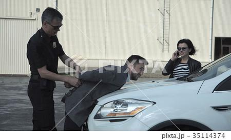 Policeman arresting delinquent 35114374