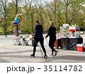 Two women walking in the park 35114782