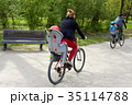 Family on bikes in the park 35114788