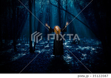 scary witch in night forestの写真素材 35122087 pixta