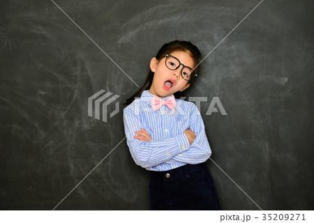 kid girl teacher standing in blackboard background 35209271