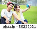 大学生 キャンパスライフ カップルの写真 35222021