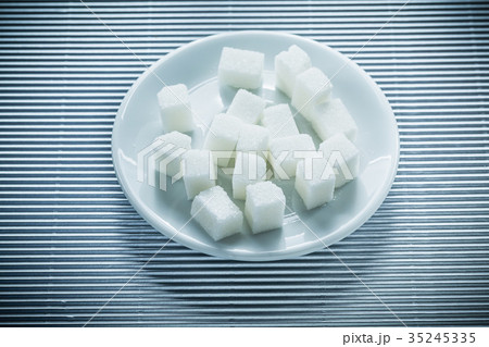 Plate with sugar cubes on striped backgroundの写真素材 [35245335] - PIXTA