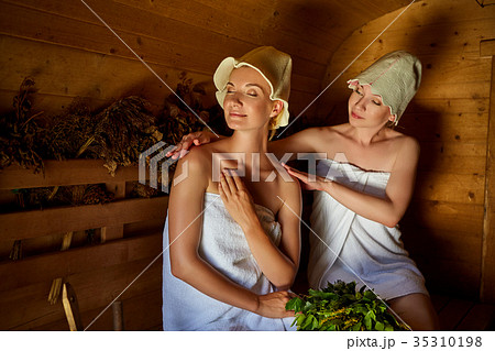 two girls relaxing in sauna 35310198