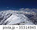 北アルプス・爺ヶ岳から望む雪の立山・剱岳 35314945