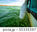 View of Green Ocean Waves from Boat Board 35335397
