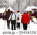 Senior women Nordic walk on snow blizzard 35434158