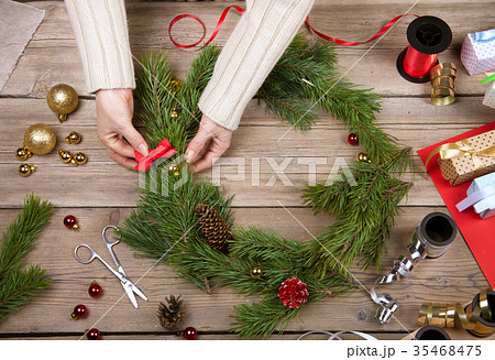 Woman making Christmas wreath. Top view 35468475