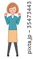 ガッツポーズをする女性 35473443