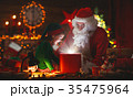 Santa Claus and little elf with magic gift for Christmas. 35475964