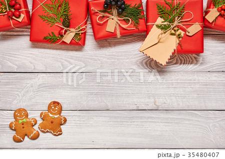 Christmas presents on wooden backgroundの写真素材 [35480407] - PIXTA