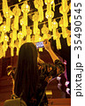 Tourist taking picture of Thai traditional lantern 35490545