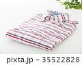 服 カジュアル シャツの写真 35522828