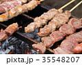 出店の焼肉串 屋台 焼肉 生肉 調理中 35548207