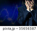 Man in despair on candlestick chart graphic 35656387