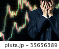 Man in despair on candlestick chart graphic 35656389