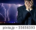 Businessman in despair on stormy sky 35656393